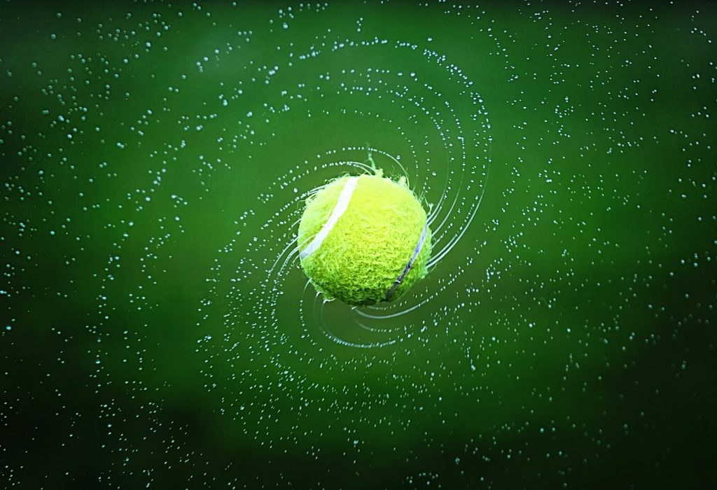 Spinning wet tennis ball.